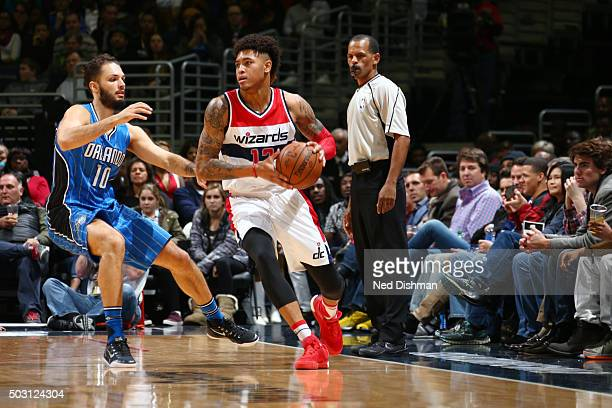 Kelly Oubre Jr #12 of the Washington Wizards moves the ball against Evan Fournier of the Orlando Magic during the game on January 1 2016 at Verizon...