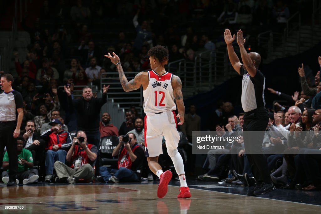 Kelly Oubre Jr. #12 of the Washington Wizards reacts to a play during the game against the Memphis Grizzlies on December 13, 2017 at Capital One Arena in Washington, DC.