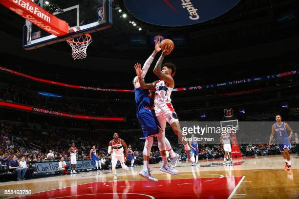 Kelly Oubre Jr #12 of the Washington Wizards shoots the ball against the New York Knicks during the preseason game on October 6 2017 at Capital One...