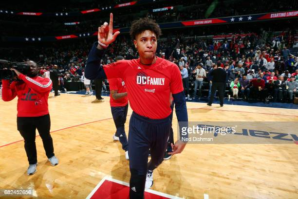Kelly Oubre Jr #12 of the Washington Wizards waves to the crowd before the game against the Boston Celtics during Game Six of the Eastern Conference...
