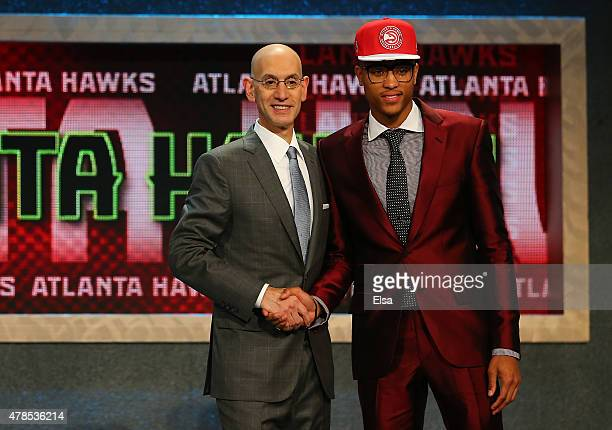 Kelly Oubre Jr poses with Commissioner Adam Silver after being selected 15th overall by the Atlanta Hawks in the First Round of the 2015 NBA Draft at...