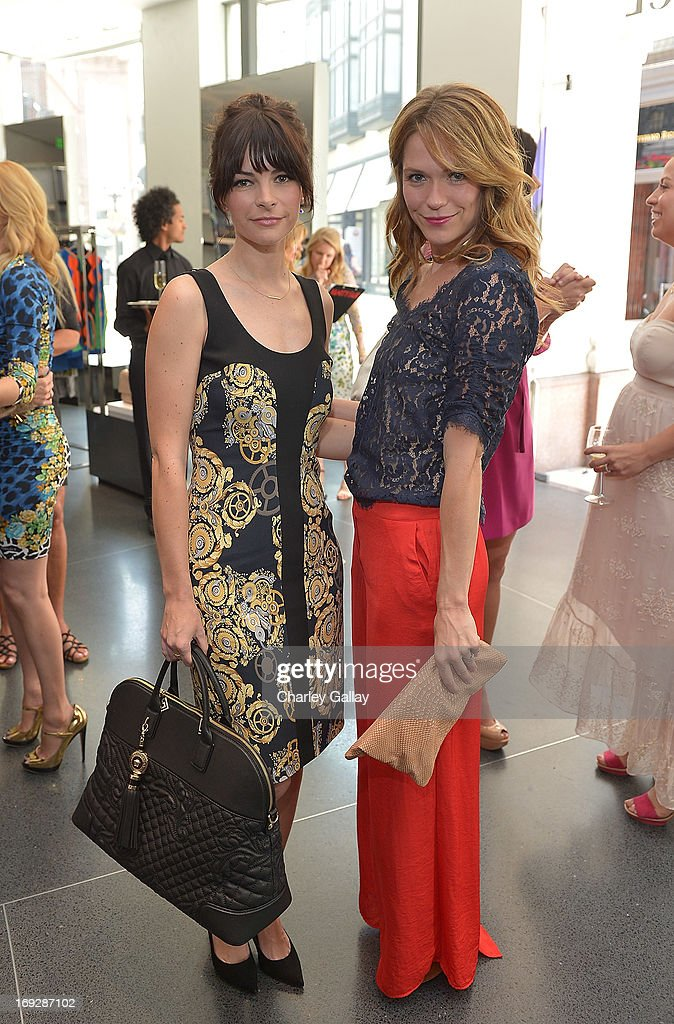 Kelly Oxford (L) attends Versace, Vanity Fair, And Elizabeth Banks Luncheon Benefitting Vital Voices Global Partnership at Versace on May 22, 2013 in Beverly Hills, California.