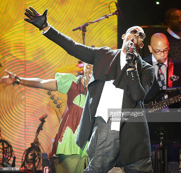R Kelly performs onstage during the Clive Davis and The Recording Academy present The Annual PreGRAMMY Gala held at The Beverly Hilton Hotel on...