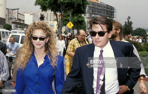 Kelly Preston and Charlie Sheen during Hollywood Walk of Fame March 24 1989 at Hollywood Boulevard in Hollywood California United States