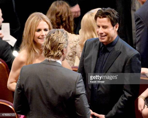 Kelly Preston and John Travolta attends the Oscars at the Dolby Theatre on March 2 2014 in Hollywood California