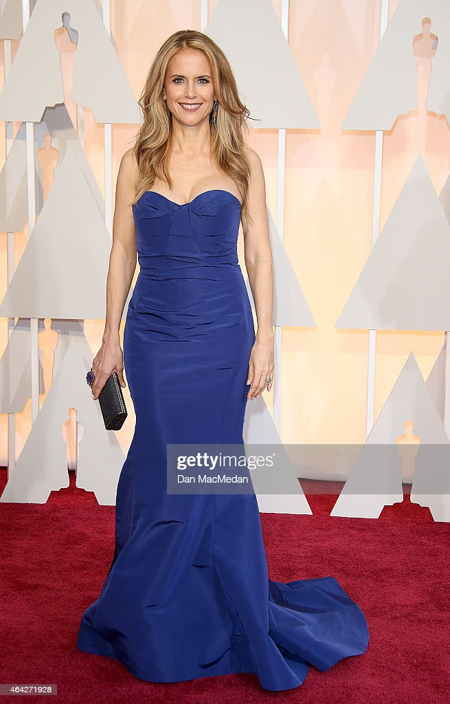 Kelly Preston arrives at the 87th Annual Academy Awards at Hollywood Highland Center on February 22 2015 in Los Angeles California