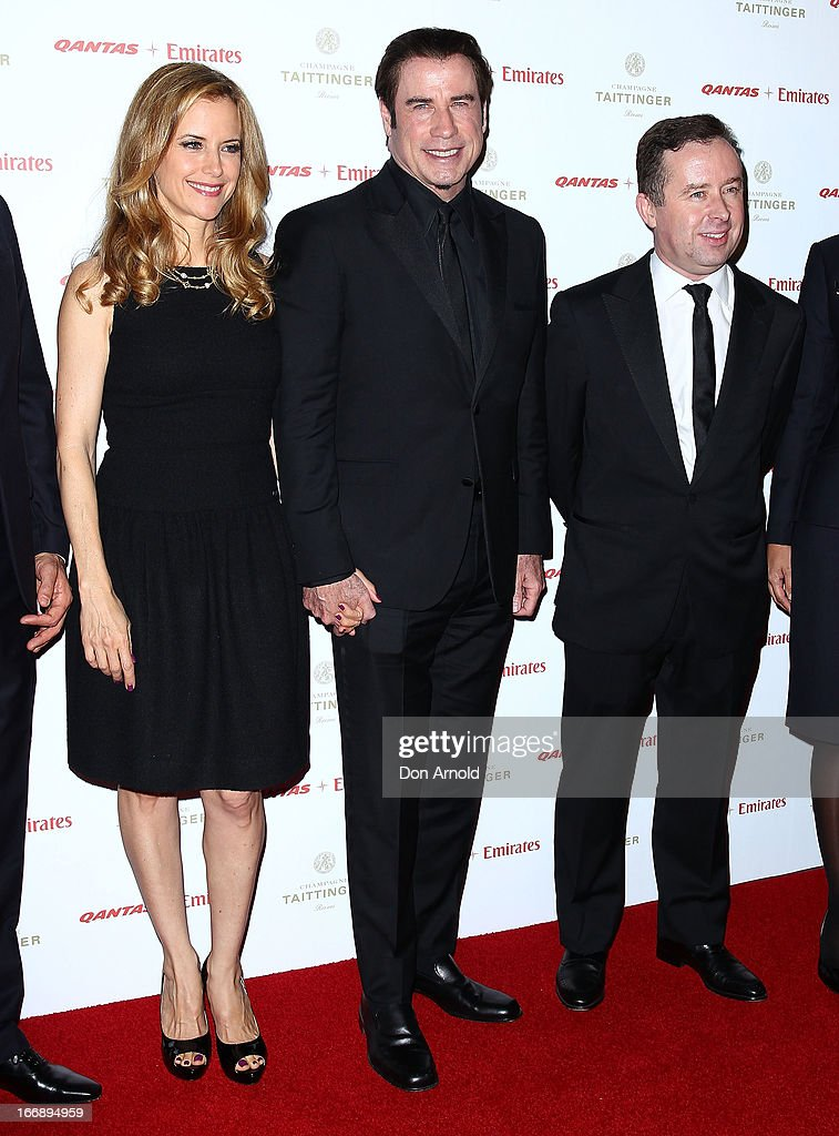 <a gi-track='captionPersonalityLinkClicked' href=/galleries/search?phrase=Kelly+Preston&family=editorial&specificpeople=159434 ng-click='$event.stopPropagation()'>Kelly Preston</a>, <a gi-track='captionPersonalityLinkClicked' href=/galleries/search?phrase=John+Travolta&family=editorial&specificpeople=178204 ng-click='$event.stopPropagation()'>John Travolta</a> and Alan Joyce pose alongside Qantas staff at the QANTAS Gala Dinner at Sydney Domestic Airport on April 18, 2013 in Sydney, Australia.