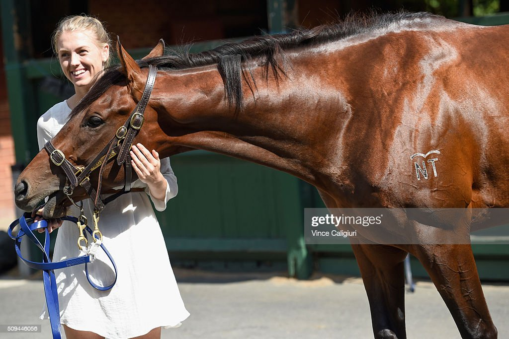 Kelly Price poses with Blue Diamond chance Flying Artie from Mick Price Racing stable during the launch of 'Relaxed Racing' carnival at Caulfield Racecourse on February 11, 2016 in Melbourne, Australia.