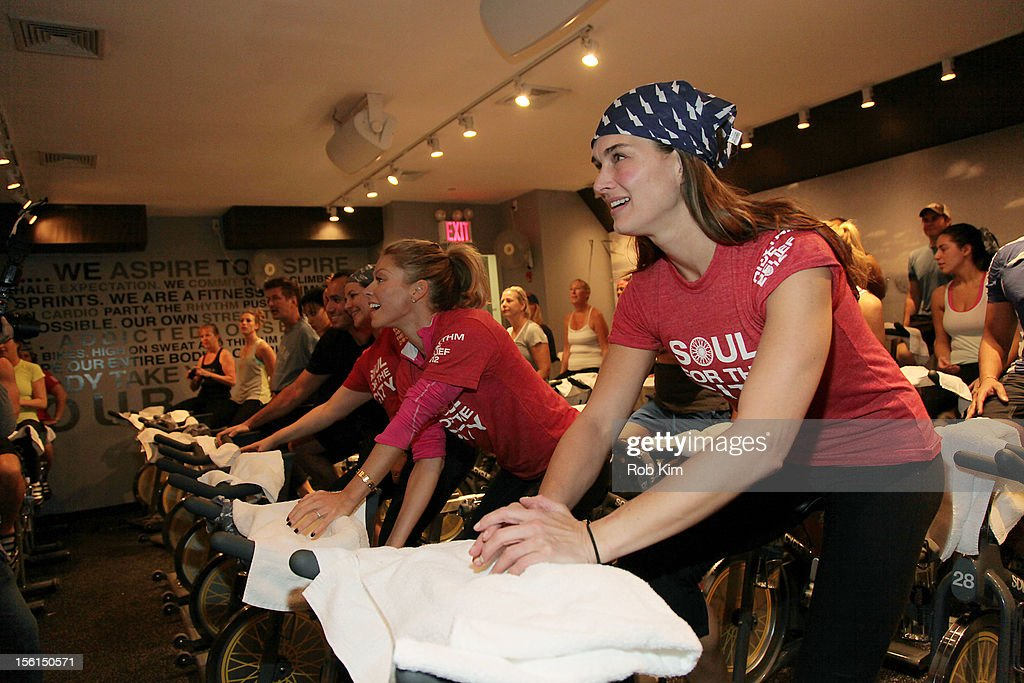 Kelly Ripa (C) and Brooke Shields (R) attend SoulCycle's Soul Relief Rides at SoulCycle Tribeca on November 11, 2012 in New York City.