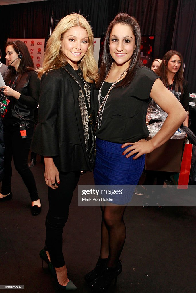 Kelly Ripa and Jordyn Wieber attend the Z100 Artist Gift Lounge Presented by Pop Tarts at Z100's Jingle Ball 2012 at Madison Square Garden on December 7, 2012 in New York City.