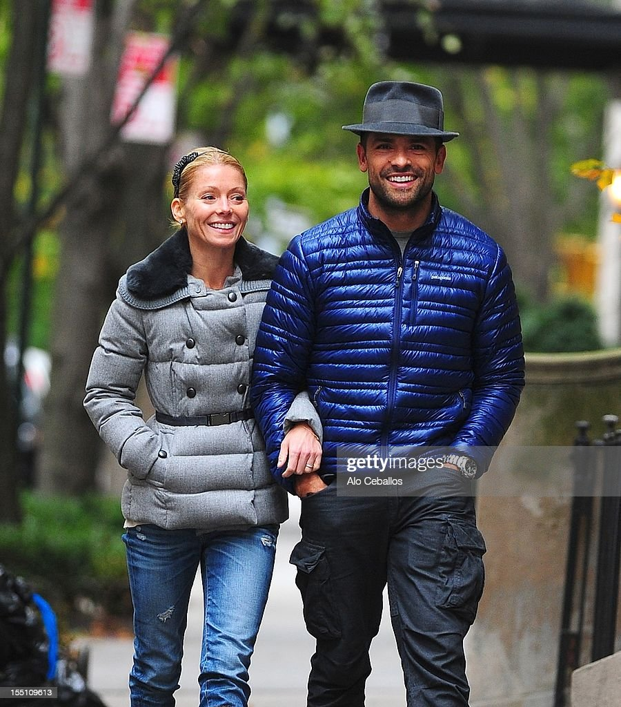 <a gi-track='captionPersonalityLinkClicked' href=/galleries/search?phrase=Kelly+Ripa&family=editorial&specificpeople=202134 ng-click='$event.stopPropagation()'>Kelly Ripa</a> and <a gi-track='captionPersonalityLinkClicked' href=/galleries/search?phrase=Mark+Consuelos&family=editorial&specificpeople=234398 ng-click='$event.stopPropagation()'>Mark Consuelos</a> are seen Upper East Side at Streets of Manhattan on November 1, 2012 in New York City.