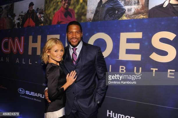 Kelly Ripa and Michael Strahan attend 2013 CNN Heroes An All Star Tribute at the American Museum of Natural History on November 19 2013 in New York...