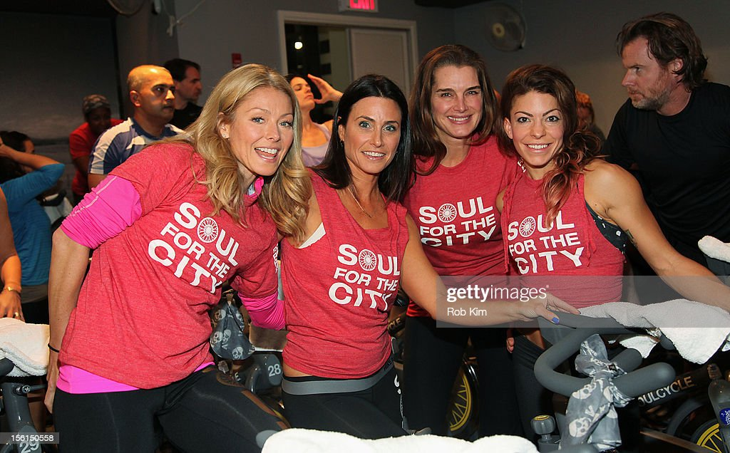 Kelly Ripa, instructor Laurie Cole, actress Brooke Shields and instructor Kym Perfetto attend SoulCycle's Soul Relief Rides at SoulCycle Tribeca on November 11, 2012 in New York City.