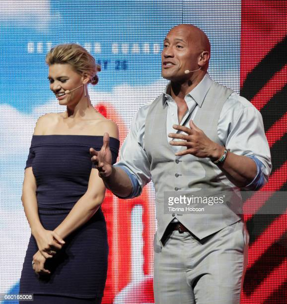 Kelly Rohrbach and Dwayne Johnson speak at Paramount Pictures' presentation highlighting its 2017 summer and beyond during CinemaCon at The Colosseum...