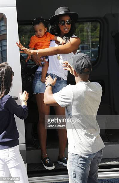 Kelly Rowland and her son Titan Jewell Witherspoon attend Serena Williams' match on day seven of the 2015 US Open at USTA Billie Jean King National...