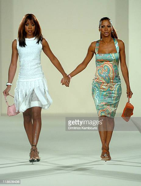 Kelly Rowland and Holly Robinson Peete wearing fashions presented by Saks Fifth Avenue at the Gridiron Glamour fashion show