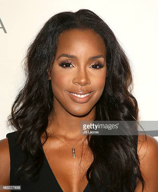 Kelly Rowland attends the BCBG Max Azria Resort 2016 collections at Samuel Freeman Gallery on August 6 2015 in Los Angeles California