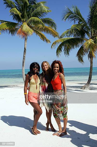 Kelly Rowland Beyonce Knowles and Michelle Williams of Destiny's Child pose for a photo on the beach during the 'MTV Destiny's Isle Contest' February...