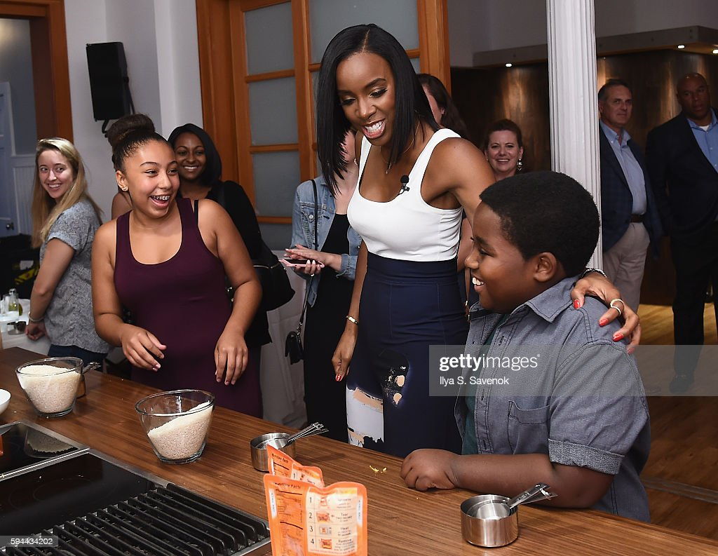 Kelly Rowland cooks with 2014 Ben's Beginners Winners during Ben's Beginners Cooking Contest Launch Event Back to the Future Of Cooking at Home...