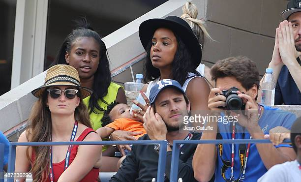 Kelly Rowland feeds her son Titan Jewell Witherspoon with milk while watching Serena Williams' match on day seven of the 2015 US Open at USTA Billie...