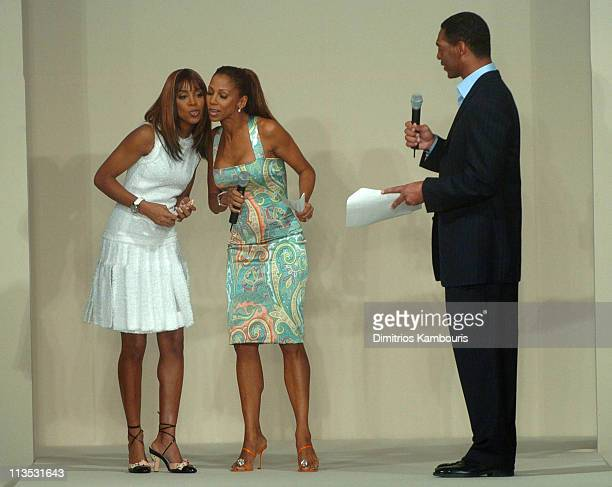Kelly Rowland Holly Robinson Peete and Marcus Allen wearing fashions presented by Saks Fifth Avenue at the Gridiron Glamour fashion show
