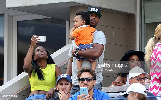 Kelly Rowland husband Tim Witherspoon and their son Titan Jewell Witherspoon attend Serena Williams' match on day seven of the 2015 US Open at USTA...