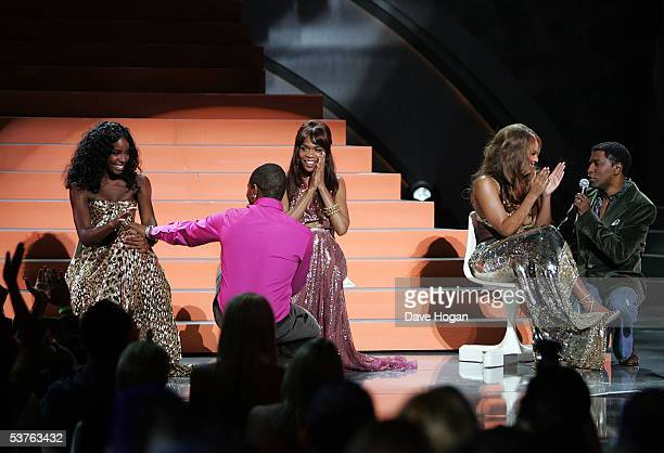 Kelly Rowland Michelle Williams and Beyonce Knowles of Destiny's Child are sung to by Kenneth 'Babyface' Edmonds and Usher onstage at the 2005 World...