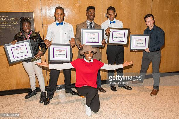 Kelly Rowland poses with winners of the 'Hometown Hero Award' at Love On Louisiana An Essence hometown heroes tribute celebrating the resilience of...