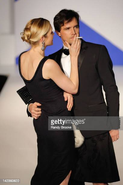 Kelly Rutherford and Matthew Settle works the catwalk during the From Scotland with Love 10th Anniversary show at The Liberty Theatre on April 2 2012...