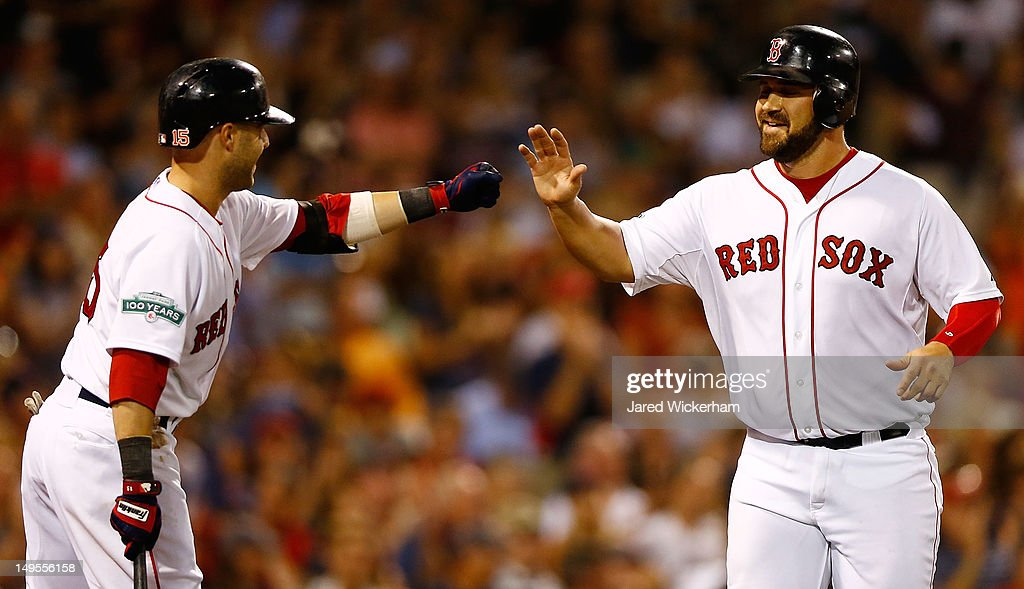 Kelly Schoppach #10 of the Boston Red Sox is congratulated by teammate <a gi-track='captionPersonalityLinkClicked' href=/galleries/search?phrase=Dustin+Pedroia&family=editorial&specificpeople=836339 ng-click='$event.stopPropagation()'>Dustin Pedroia</a> #15 after scoring against the Detroit Tigers in the seventh inning during the game on July 30, 2012 at Fenway Park in Boston, Massachusetts.