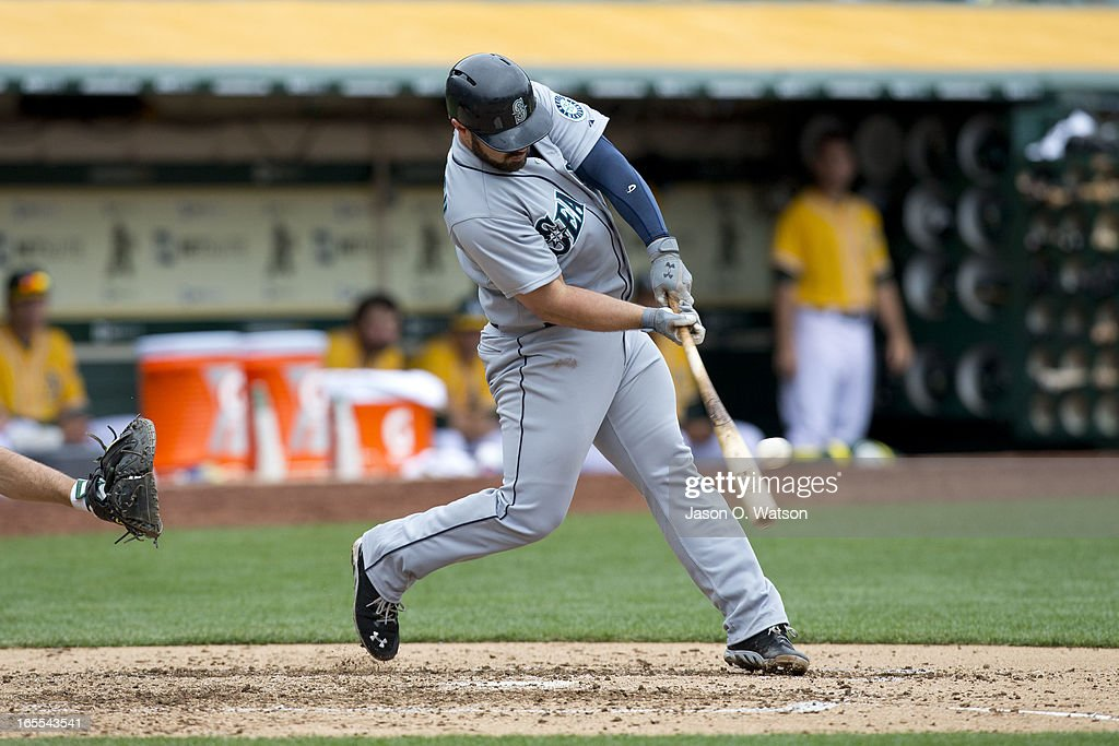 <a gi-track='captionPersonalityLinkClicked' href=/galleries/search?phrase=Kelly+Shoppach&family=editorial&specificpeople=194967 ng-click='$event.stopPropagation()'>Kelly Shoppach</a> #7 of the Seattle Mariners hits a single against the Oakland Athletics during the fifth inning at O.co Coliseum on April 4, 2013 in Oakland, California. The Oakland Athletics defeated the Seattle Mariners 8-2.