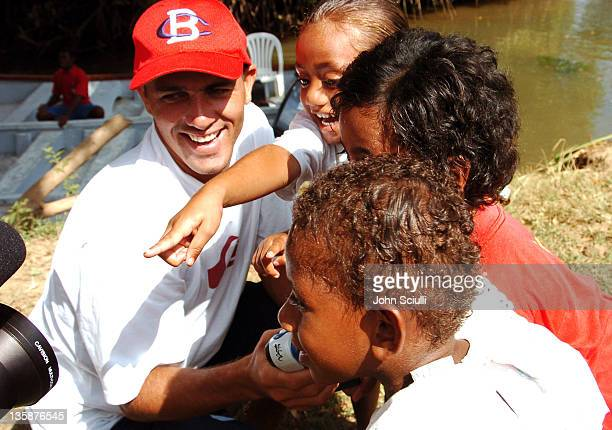 Kelly Slater and village children during Kelly Slater Invitational Fiji Day 2 Mome Village Tour in Mome Village Tavarua Island Fiji