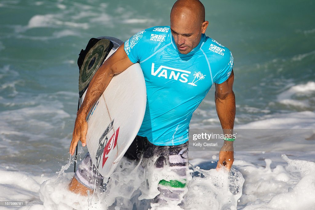 Kelly Slater of the United States exits the water after being eliminated from the Vans World Cup of Surfing at Sunset Beach on December 4, 2012 in North Shore, Hawaii.