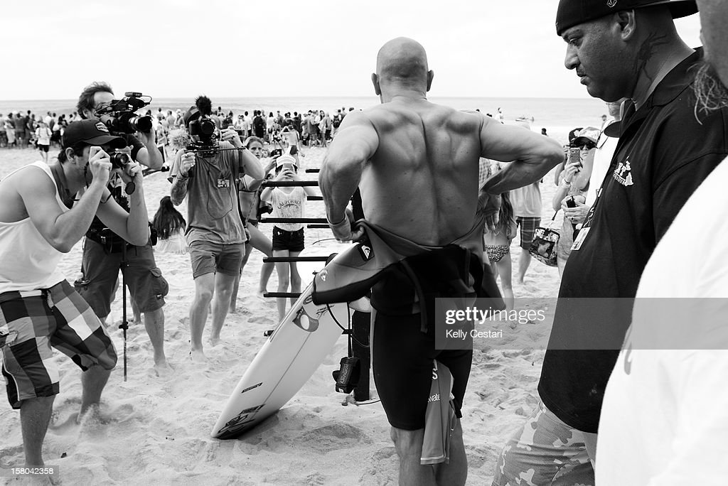 Kelly Slater of the United States is mobbed by media and fans as he prepares for his Billabong Pipe Masters Round 3 heat on December 9, 2012 in North Shore, Hawaii.