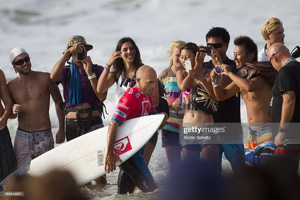 <a gi-track='captionPersonalityLinkClicked' href=/galleries/search?phrase=Kelly+Slater&family=editorial&specificpeople=207101 ng-click='$event.stopPropagation()'>Kelly Slater</a> of the United States is photographed by the crowd as he exits the water during the Quiksilver Pro, on March 12, 2013 in Gold Coast, Australia.