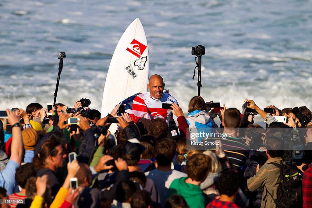 <a gi-track='captionPersonalityLinkClicked' href=/galleries/search?phrase=Kelly+Slater&family=editorial&specificpeople=207101 ng-click='$event.stopPropagation()'>Kelly Slater</a> of the United States of America is carried on people's shoulders through the crowd after winning the Quiksilver Pro France on October 5, 2012 in Hossegor, France.