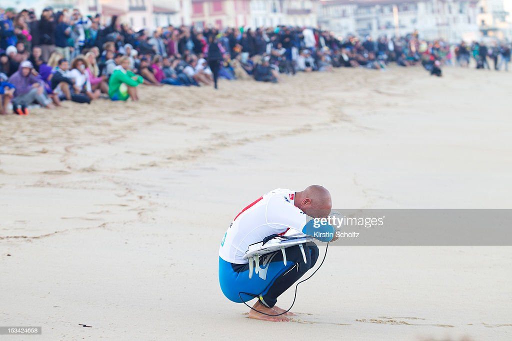 <a gi-track='captionPersonalityLinkClicked' href=/galleries/search?phrase=Kelly+Slater&family=editorial&specificpeople=207101 ng-click='$event.stopPropagation()'>Kelly Slater</a> of the United States of America prays before his heat on October 5, 2012 in Hossegor, France.