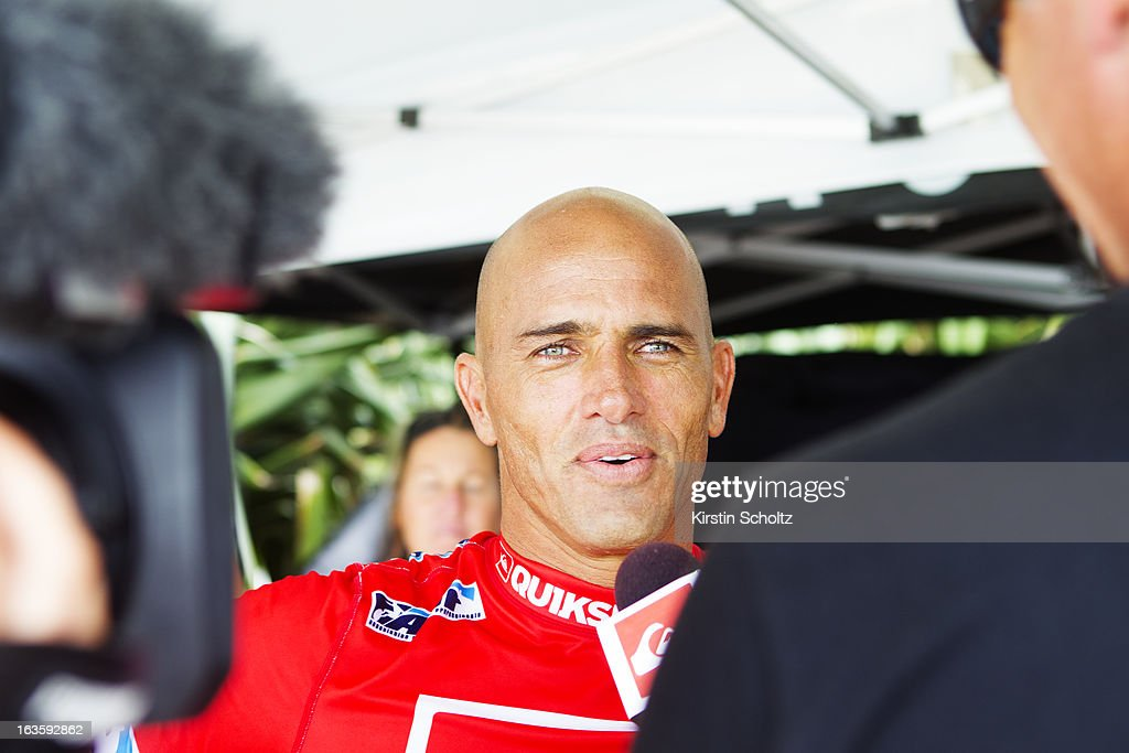 <a gi-track='captionPersonalityLinkClicked' href=/galleries/search?phrase=Kelly+Slater&family=editorial&specificpeople=207101 ng-click='$event.stopPropagation()'>Kelly Slater</a> of the United States of America talks through his semifinal victory on the webcast during the Quiksilver Pro on March 13, 2013 in Gold Coast, Australia.