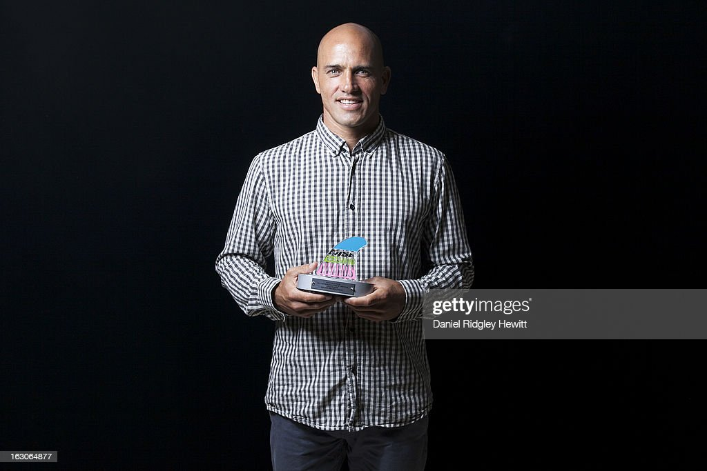 <a gi-track='captionPersonalityLinkClicked' href=/galleries/search?phrase=Kelly+Slater&family=editorial&specificpeople=207101 ng-click='$event.stopPropagation()'>Kelly Slater</a> of the United States of America with his 2012 ASP Manuever of the Year Award at the 2013 ASP World Surfing Awards on February 28, 2013 in Surfers Paradise, Australia. (Photo by Daniel Ridgley Hewitt/ASP via Getty Images