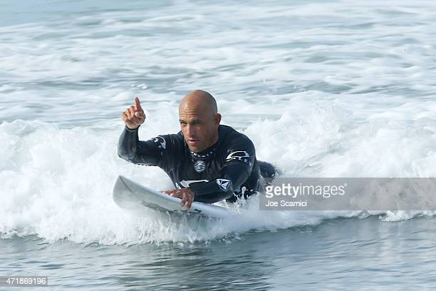 Kelly Slater of the US comes in for a board change in the round of 24 during the Oakley Lower's Pro at Lower Trestles on May 1 2015 in San Clemente...