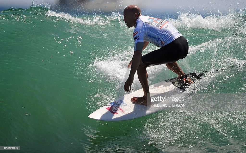 Kelly Slater of the US competes in the final of the US Open of Surfing in Huntington Beach on August 7 2011 in southern California where the tentime...