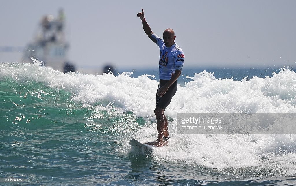 Kelly Slater of the US gestures number one after competing in the final of the US Open of Surfing in Huntington Beach on August 7 2011 in southern...