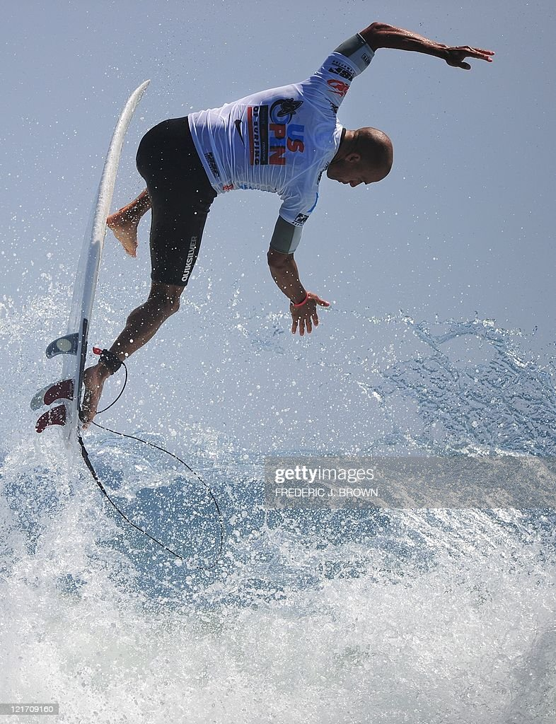 Kelly Slater of the US has fun on his board after competing in the final of the US Open of Surfing in Huntington Beach on August 7 2011 in southern...