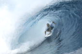 Kelly Slater of the USA in action captured his first win since 2000 during the Billabong Pro May 15 2003 at Teahupoo Tahiti The Billabong Pro...