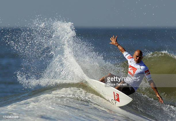 Kelly Slater of the USA rides the waves in the semifinal round at the Quiksilver Pro New York tournament on September 9 2011 in Long Beach New York