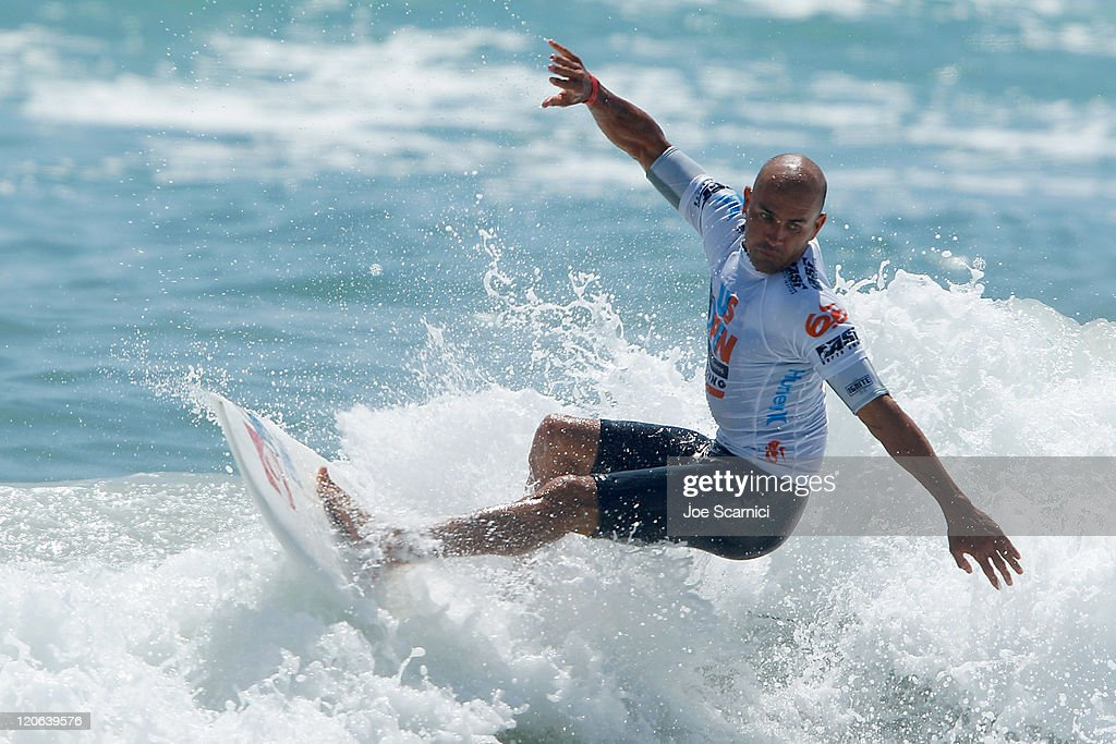 Kelly Slater of USA cuts back on an inside wave during his heat against Yadin Nicols of Australia at the Nike US Open of Surfing on August 7 2011 in...