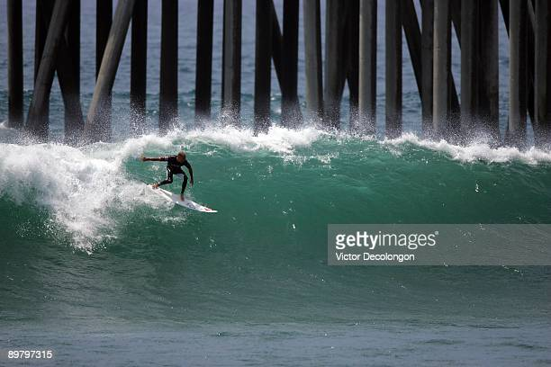 Kelly Slater takes off on a left toward the Huntington Beach Pier during the WPS AllStars Towin Expression Session as part of the 2009 Hurley US Open...