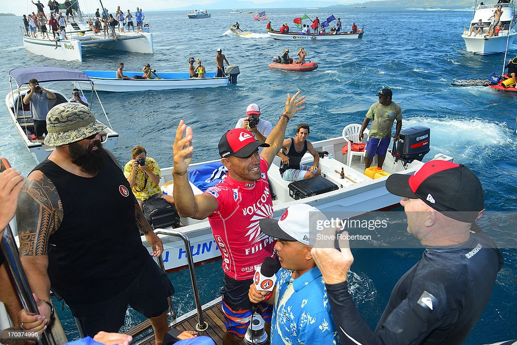 <a gi-track='captionPersonalityLinkClicked' href=/galleries/search?phrase=Kelly+Slater&family=editorial&specificpeople=207101 ng-click='$event.stopPropagation()'>Kelly Slater</a> winner of the Volcom Pro Fiji today, where he defeated Mick Fanning of Australia, celebrates on June 12, 2013 in Tavarua, Fiji. Slater is back as the world rankings leader for 2013.