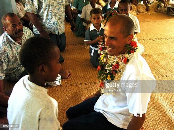 Kelly Slater with village child during Kelly Slater Invitational Fiji Day 2 Mome Village Tour in Mome Village Tavarua Island Fiji
