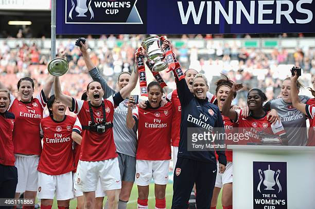 Kelly Smith and Shelley Kerr of Arsenal Ladies lift the trophy after winning the FA Women's Cup Final match between Everton Ladies and Arsenal Ladies...